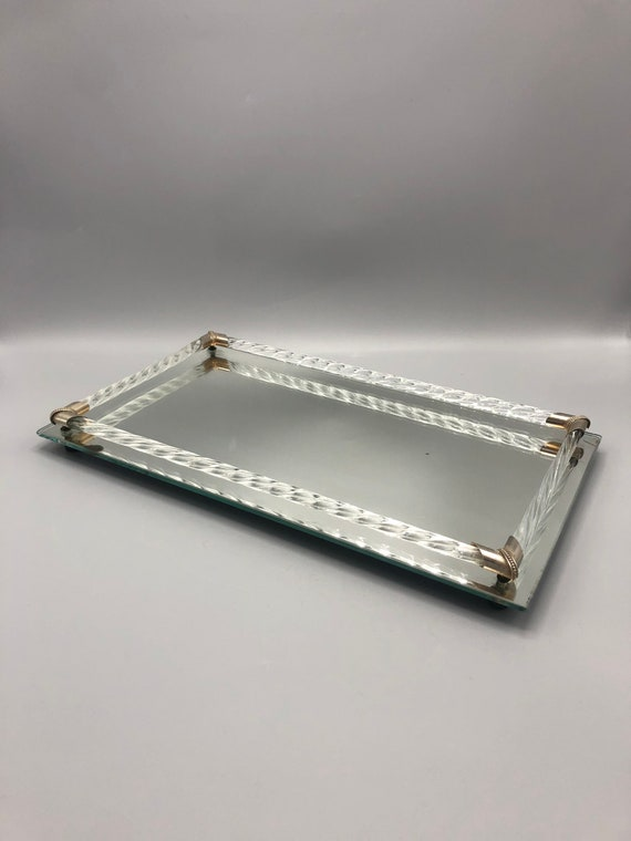 Mid century Hollywood Regency mirror glass tray with glass handles frame with brass detail on the corner