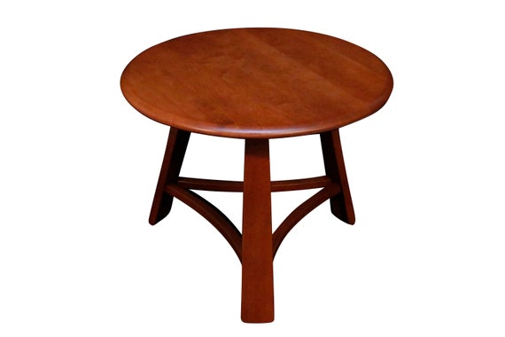 Curated Mid-Century circle maple end table with 3 legs. Was completely restored. 1960's Circa.