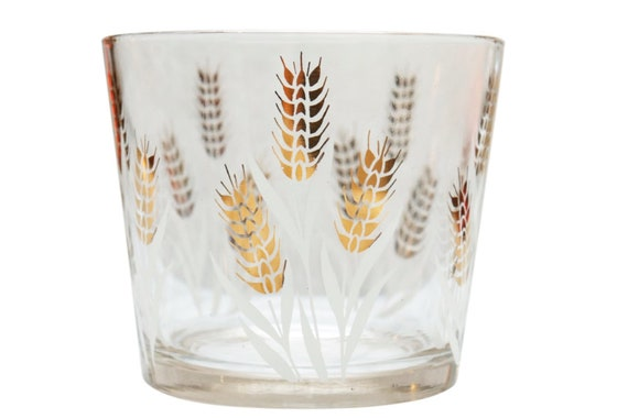 Mid century glass ice bucket with black & Gold coins.