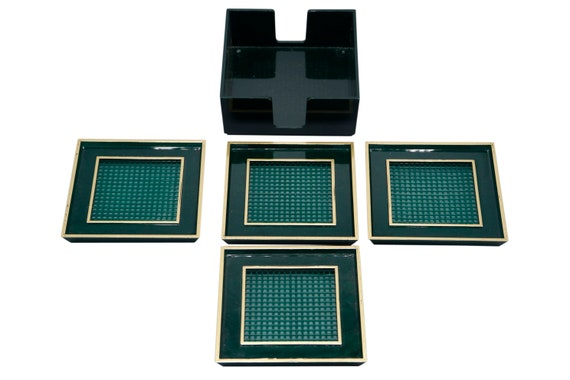 Mid century Lucite green coasters in a box set of four