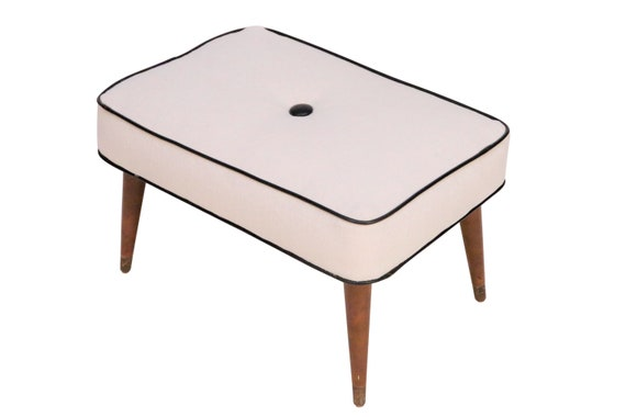 Curated Mid century  ottoman/foot stool with new foam & kvadrat cream fabric with walnut wood legs.