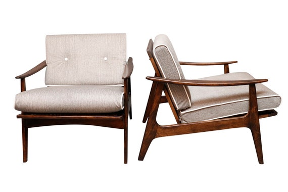mid century curated pair of walnut arm chairs with the new velvet cushions.