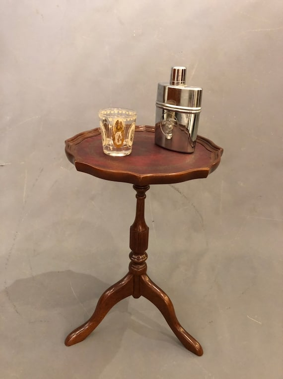 Mid century mahogany small one end table with leather on top