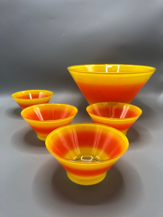 Mid century bright yellow and orange deep and chip bowl with four small bowls 1960's circa