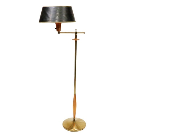 Mid-Century Copper floor lamp with adjustable glass shade.