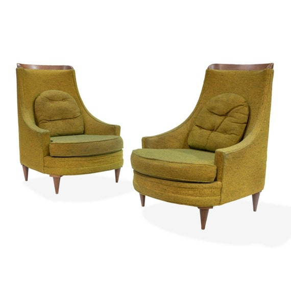 "A pair of high back Selig  Imperial lounge chairs with walnut crest and  legs.  Dimensions -39"" x 30"" x 28"""
