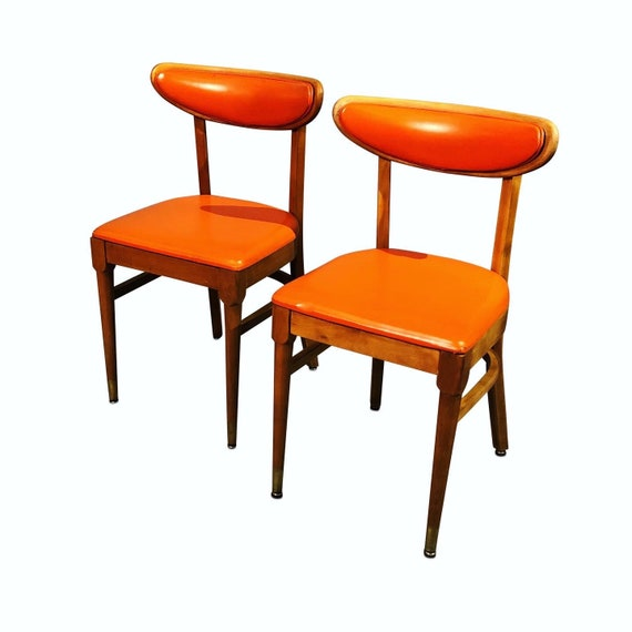 Mid century pair from the dining chairs with original orange vinyl maple wood