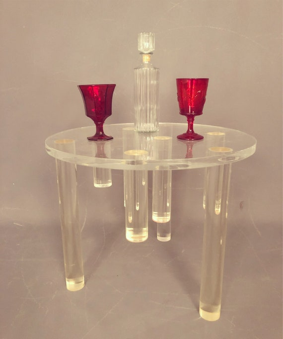 Stunning mid-Century round Lucite coffee table with tubes.