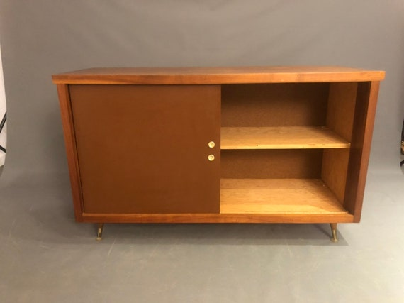 Mid-Century cabinet Danish With Sliding Doors and inner shelf.
