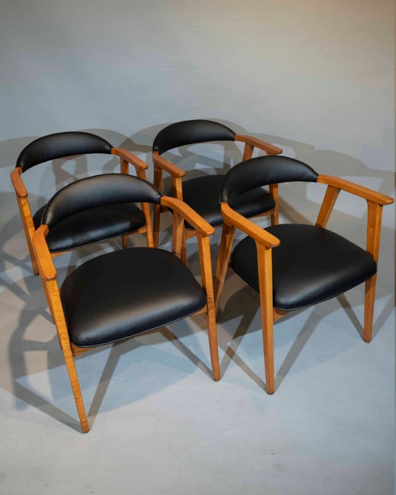 Mid century curated set of 4 dining chairs with black vinyl leather