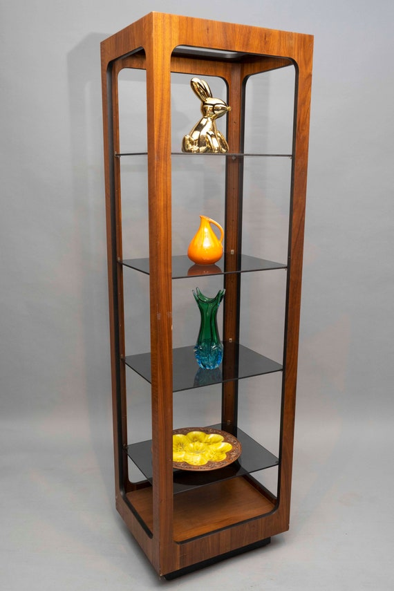 Mid-Century walnut etagere bookcase with glass shelves.