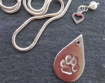 Silver hand crafted paw print pendant