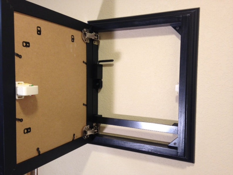 Black Frame with hidden storage and magnetic locking system
