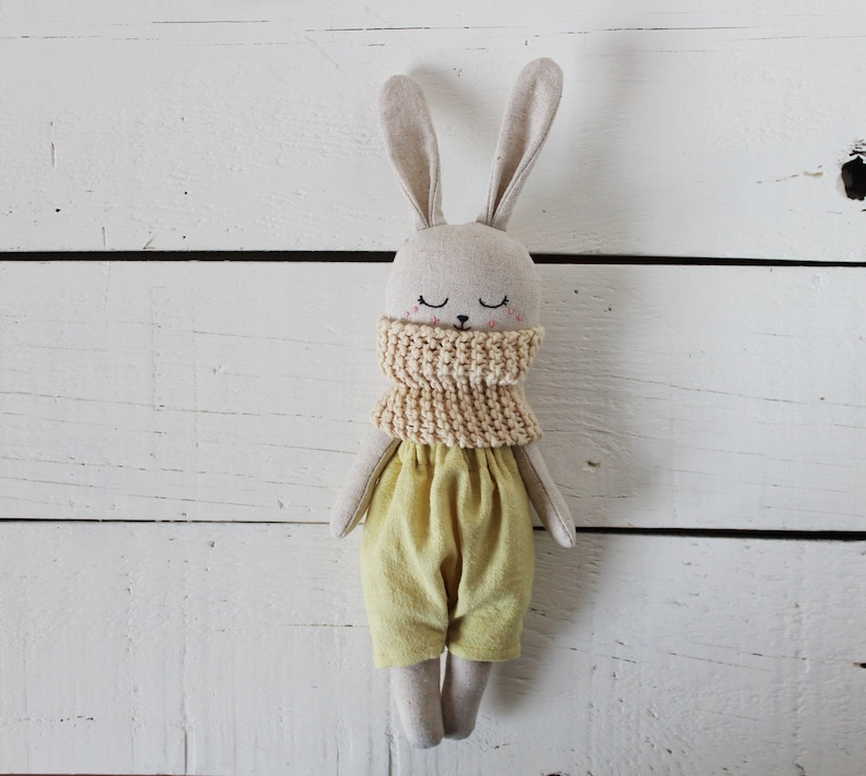 Bunny doll with light yellow pants. Rabbit doll with scarf. image 0