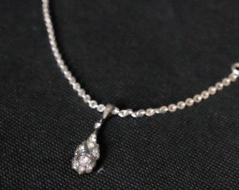 Silver Pendant inlaid with diamonds