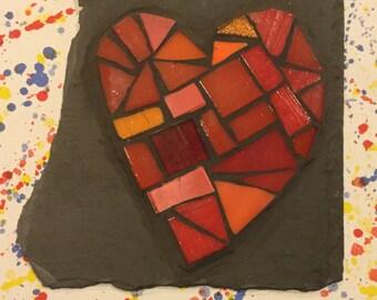 Red mosaic heart on slate