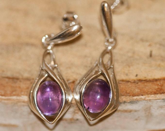 Amethyst Earrings fitted in a Sterling Silver. Dangle amethyst earrings .Amethyst jewelry, elegant earrings. Drop earrings