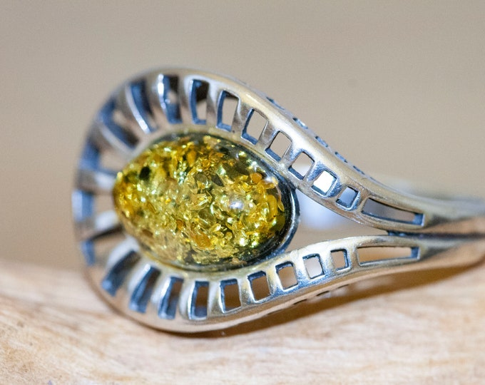 Baltic amber ring. Green kind of Baltic amber. Sterling silver setting. Perfect gift. Designer ring. Amber jewelry. Celtic design. Unique.