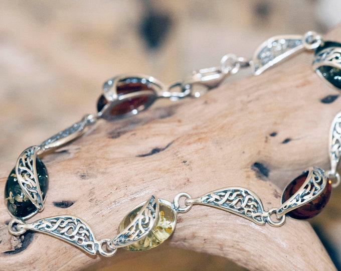 Amber bracelet. Baltic amber in sterling silver. Silver bracelet. Links bracelet. Gift for her. Three kinds of amber. Celtic design.