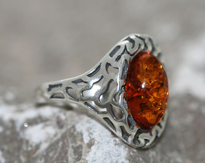 Baltic amber ring. Large cognac piece of Baltic amber fitted in sterling silver setting. Many sizes.