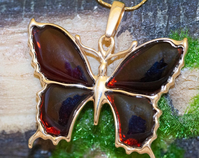 Amber & Gold. Four pieces of dark cognac amber. Butterfly shaped setting. Gold pendant. Amber jewelry. Contemporary design. Unique pendant.