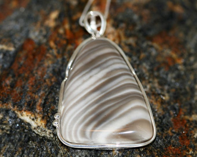 Striped Flint pendant fitted in sterling silver setting.