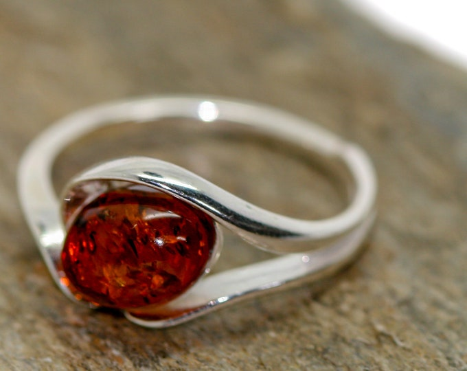 Baltic amber ring. Cognac piece of Baltic amber in sterling silver setting. Oval amber. Many sizes. Designer ring. Amber jewelry. Elegant.