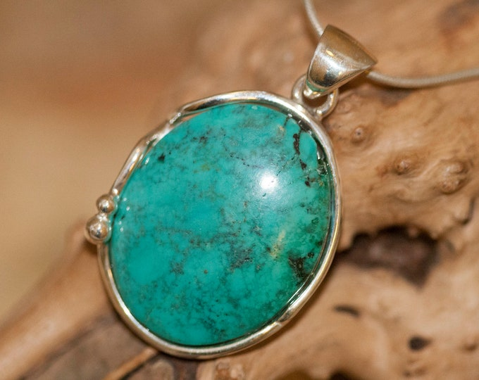 Amazing Turquoise Pendant fitted in Sterling Silver setting. Turquoise necklace. Design jewelry. Contemporary jewelry. Turquoise.