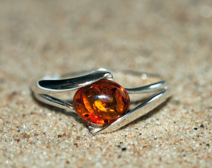 Baltic amber ring. Cognac piece of Baltic amber in sterling silver setting. Oval amber. Designer ring. Amber jewelry. Elegant.