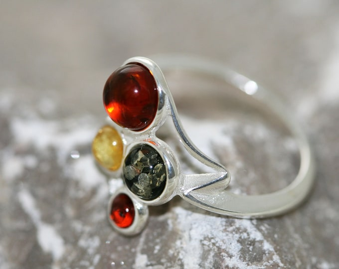 Baltic amber ring. Four pieces of amber in three different shades fitted in sterling silver setting. Statement ring.