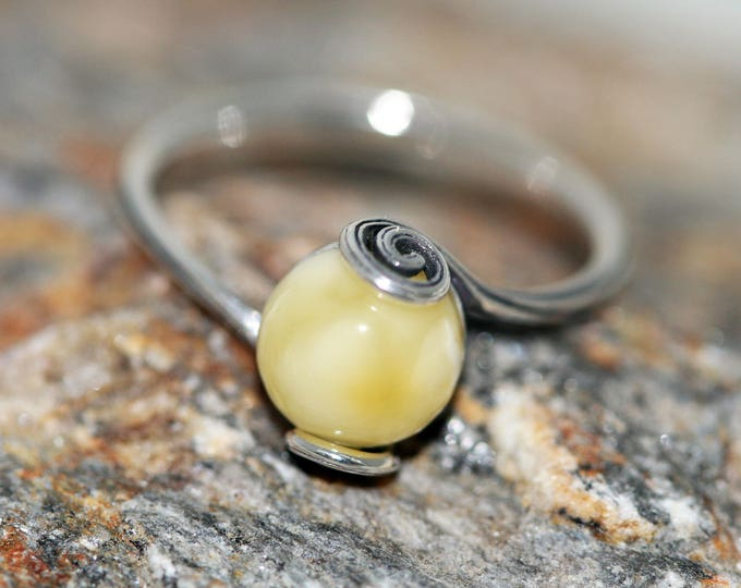Baltic amber ring. Milky piece of Baltic amber in sterling silver setting. Many sizes.