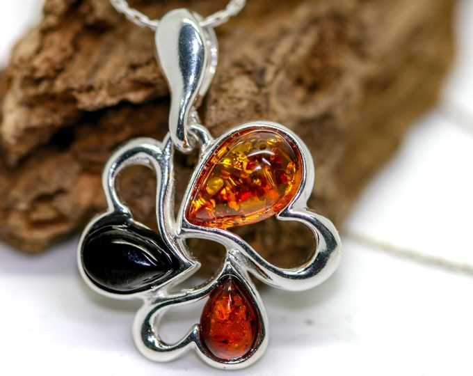 Heart shaped pendant. Whitby Jet and Amber pendant. Sterling Silver Pendant, British jewellery. Contemporary jewelry. Genuine Whitby Jet.