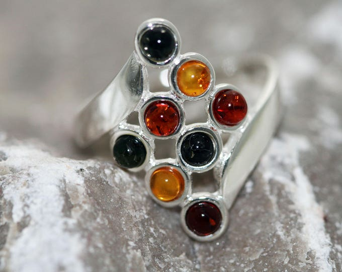 Baltic amber ring. Eight pieces of amber in three different shades fitted in sterling silver setting. Statement ring.
