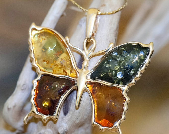 Amber & Gold. Four pieces of Baltic amber. Butterfly shaped setting. Gold pendant. Amber jewelry. Contemporary design. Unique pendant.