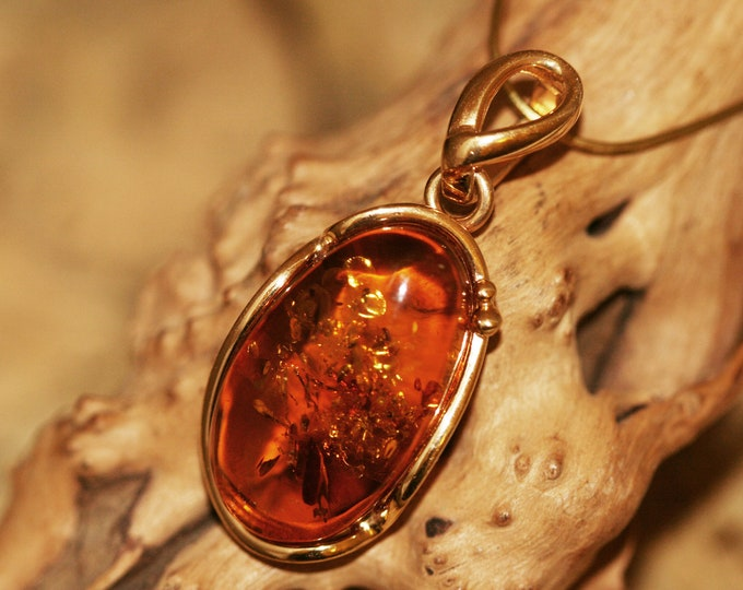 Amber & Gold Pendant. Natural amber necklace. Baltic amber fitted in 14 CT Gold plated sterling silver setting.