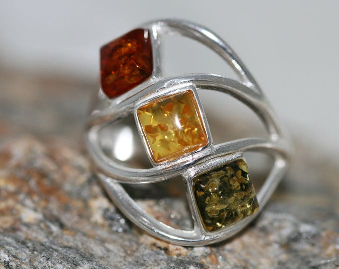 Large Baltic amber ring. Three pieces of amber in different shades fitted in sterling silver setting. Statement ring.