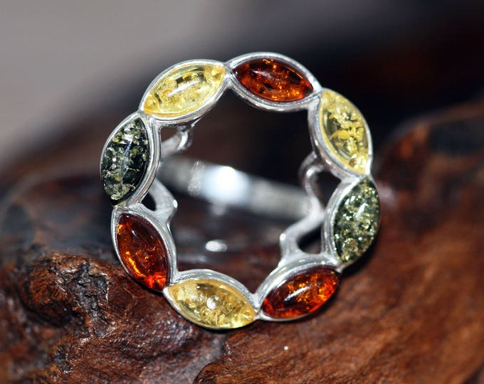 Baltic amber ring. Three different shades of Baltic amber in sterling silver setting.