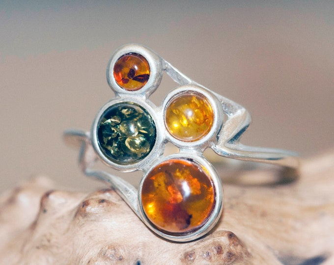Baltic amber ring. Four pieces of amber in three different shades. Sterling silver setting. Designer ring. Contemporary design. Gift for her