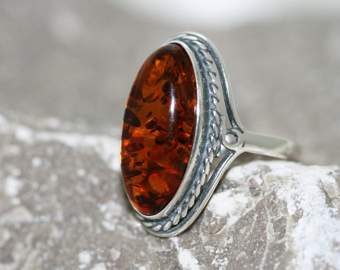 Baltic amber ring. Cognac piece of Baltic amber fitted in sterling silver setting. Many sizes.