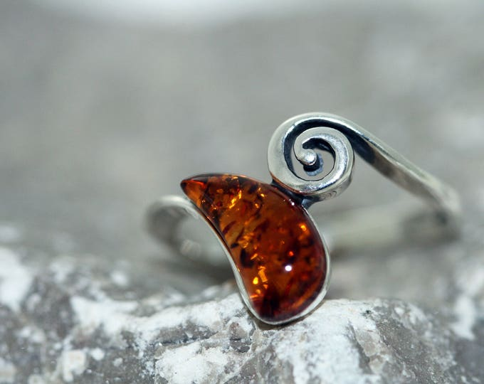 Baltic amber ring. Cognac piece of Baltic amber in sterling silver setting. Many sizes.