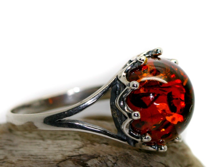 Baltic amber ring. Cognac piece of Baltic amber in sterling silver setting. Round amber. Many sizes.