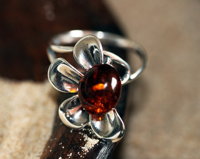 Baltic amber ring. Cognac Baltic amber in sterling silver setting.