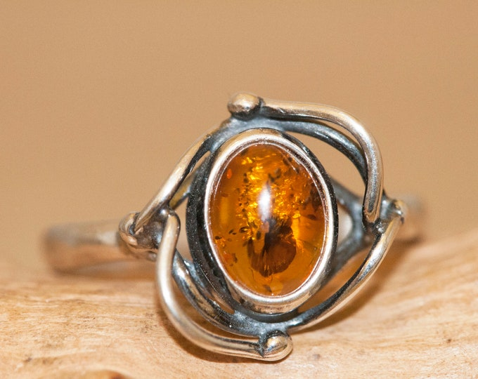 Baltic amber ring. Cognac piece of Baltic amber fitted in sterling silver setting. Many sizes. Viking jewelry, unique ring,medieval, celtic