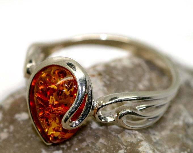 Baltic amber ring. Cognac piece of Baltic amber in sterling silver setting. Teardrop shaped amber. Many sizes. Modern design