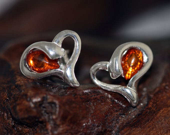 Heart shaped studs. Baltic Amber Earrings fitted in a Sterling Silver. Valentine's Day gift. Amber jewelry, heart shaped earrings, elegant