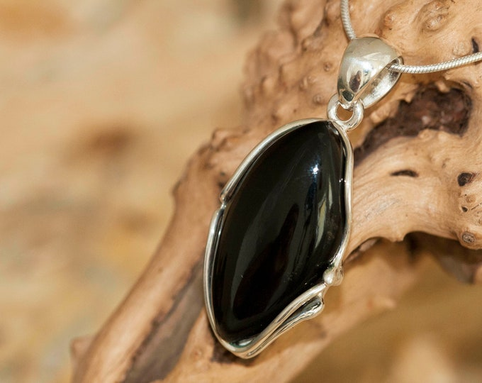 Black Onyx Pendant fitted in Sterling Silver setting. Onyx pendants. Onyx necklace, silver pendant. Onyx jewellery. Onyx necklaces