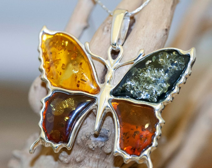 Amber & Silver. Four diferent kinds of Baltic amber. Butterfly shaped setting. Sterling silver. Amber jewelry. Contemporary design. Unique.