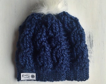 Infant cabled beanie topped with faux fur pom
