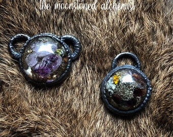 Nature blob amulets infused with Amethyst and Garnet Crystal - real moss, colorful lichen, and bark immortalized and set in dark copper