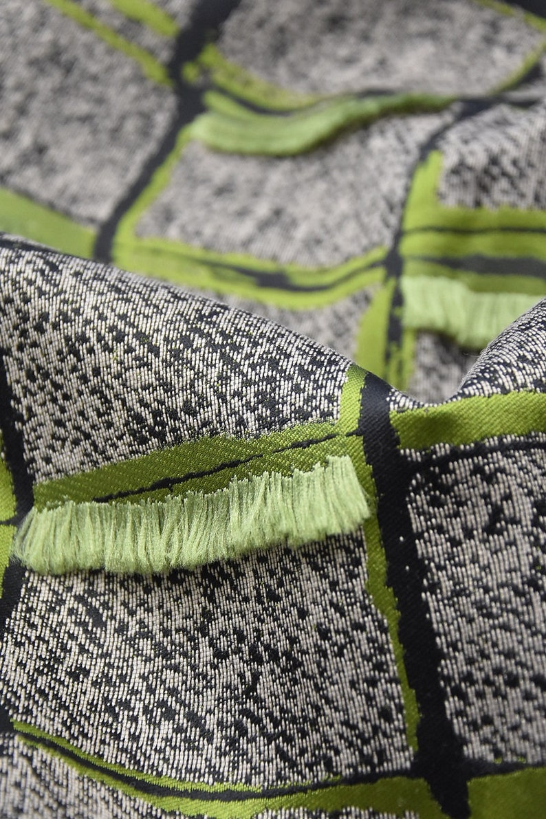 Jacquard with silk gray with green tint in a cage with fringe 4491